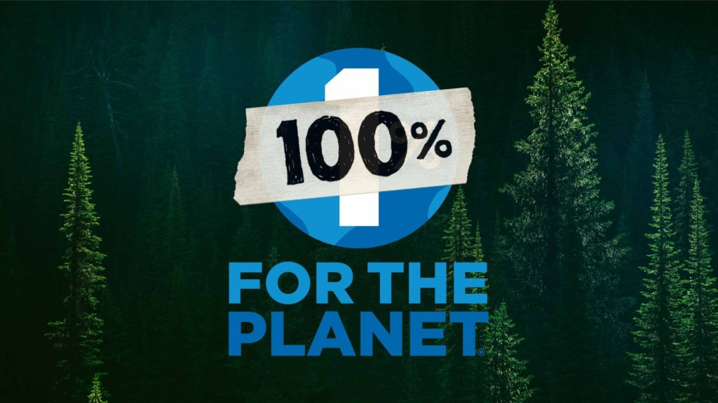 Patagonia marketing image showing some tall spruce trees with a stamp saying 100% for the planet across the image.