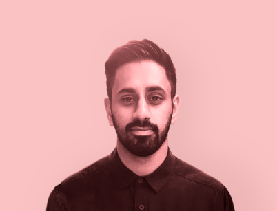 A monochrome image of the head and shoulders of Manny Dhanda with a pink filter